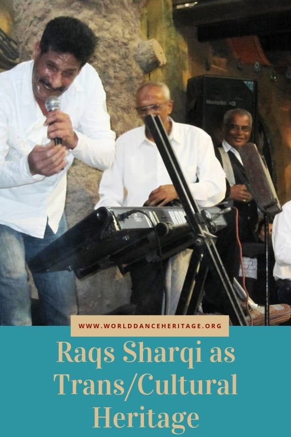 Raqs sharqi musicians including drummer and singer.
