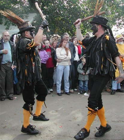 Men performing the traditional morris dancing in the UK